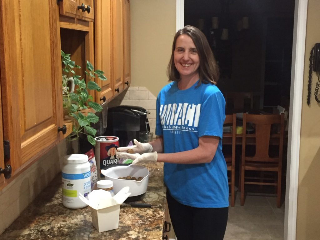 Kris Siegenthaler in the kitchen making Protein Peanut Butter Chocolate Energy Balls.