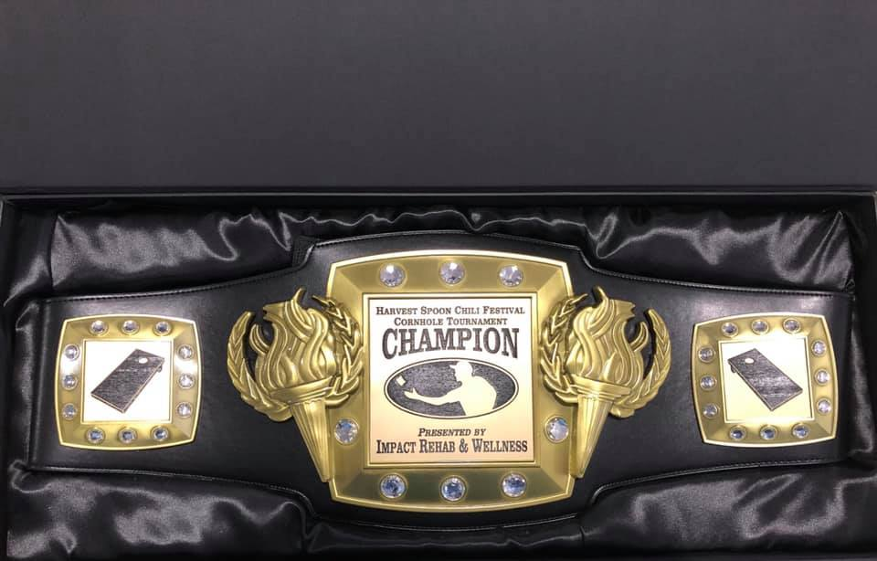 "Championship ""wrestling"" belt for the Cornhole Tournament at the Chili Festival sponsored by Impact Rehab & Wellness."