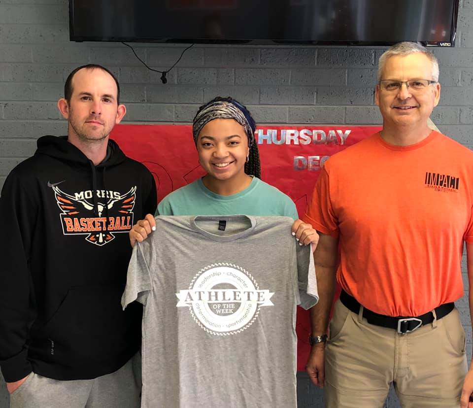 Impact Athlete of the Week winner, Jazmyn Powell, pictured with coach Ty Allen and Michael Siegenthaler.