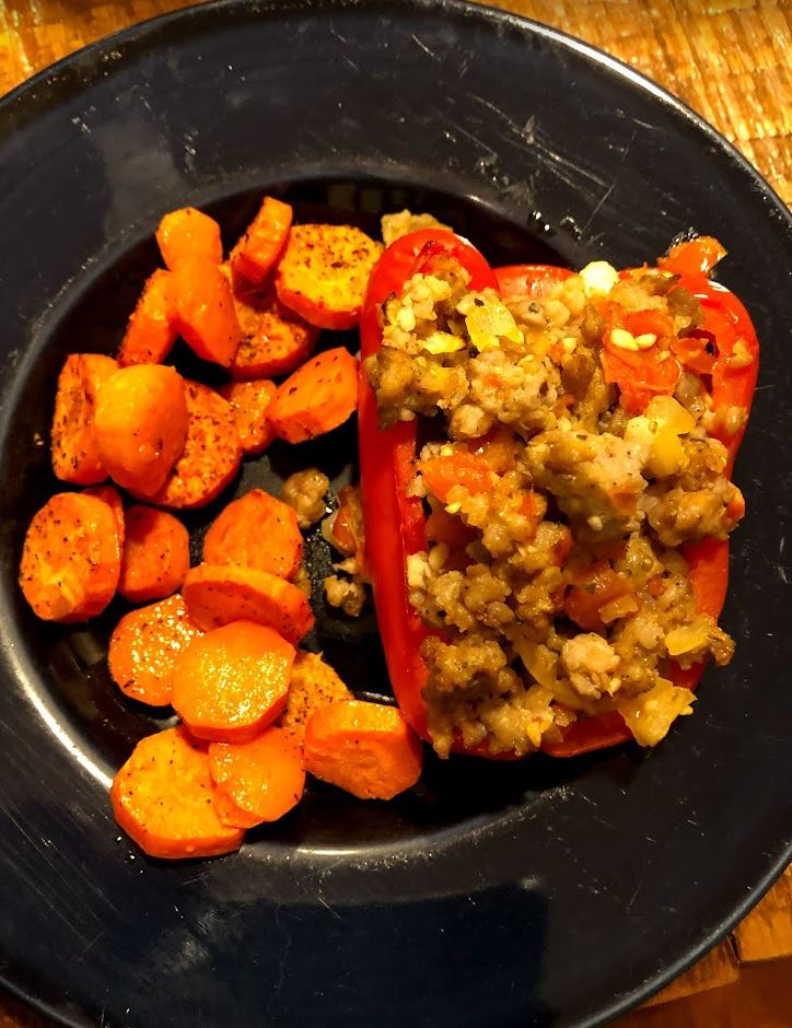 Stuffed bell pepper with roasted carrots.